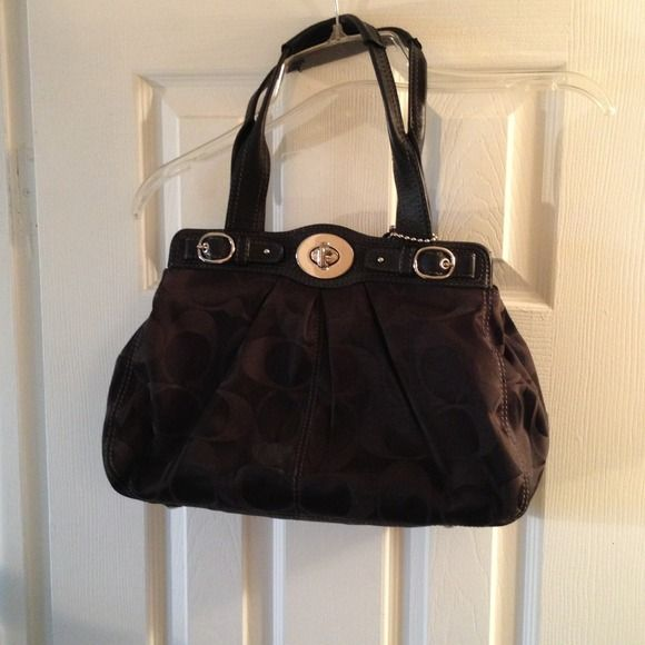 Black Coach Purse Black with lilac interior. Small stain inside around middle zipper. Coach Bags