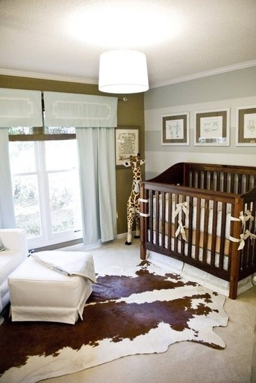 Chic nursery design, stripped wall, brown and blue, window treatment, cowhide rug
