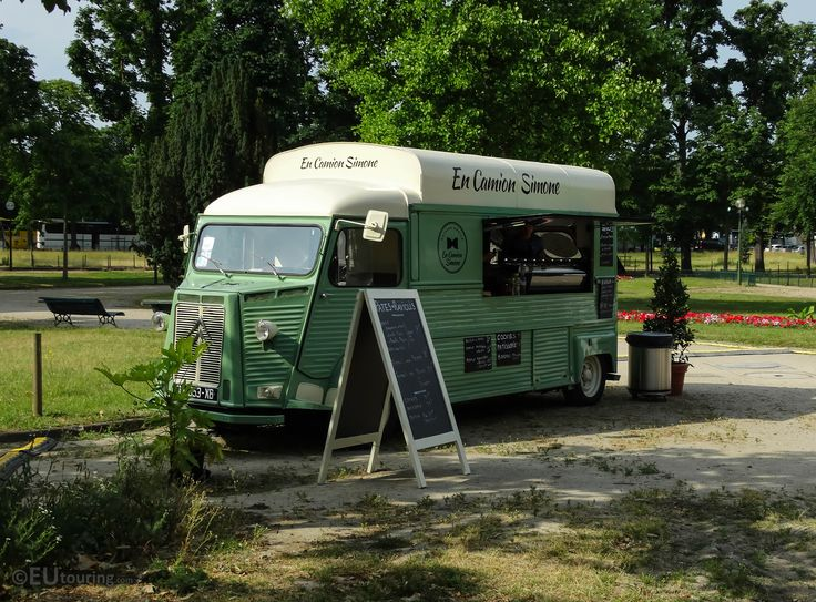 A vintage styled mobile food van, named En Camion Simone, taken while it was within the Champs Elysees gardens.  More at; www.eutouring.com/images_paris_city_life.html