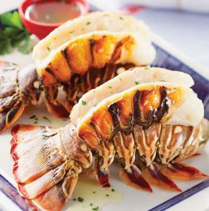 No need to be intimated by lobster! All you need to do is thaw, snip the shells and roast. Lobster Tails with Garlic-Butter Sauce are perfect for Mother's Day.