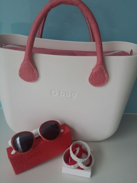 White o bag with red stripe handles