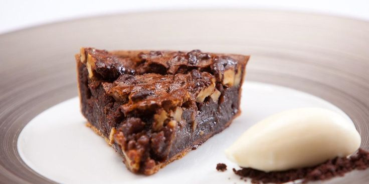 This rich chocolate and walnut tart from Shaun Rankin is served with crème fraîche ice cream to make a majestic dessert