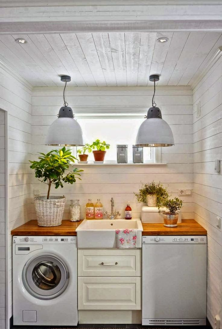 Interior inspirations on the blog - really like this practical and functional laundry room, fresh flowers, colours and bringing nature in
