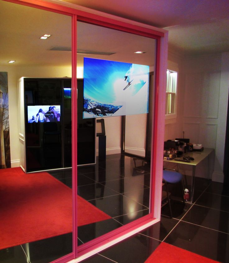 We are the only company in Europe offering this unique product 'The sliding mirror with integrated TV'. This luxury item can also include integrated Xbox, Playstation, Apple TV and many more. It was designed to keep wires tucked away and out of site for more information visit the website www.clarksonsofcheshire.co.uk