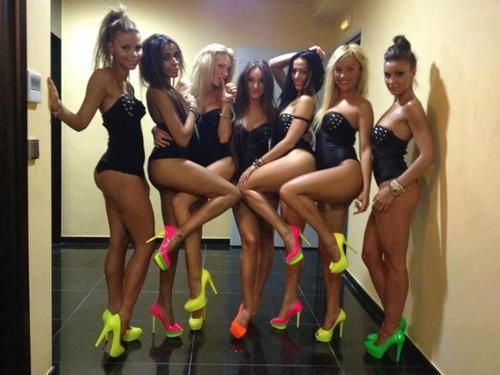 Wear little black dresses with neon shoes for a bachelorette party