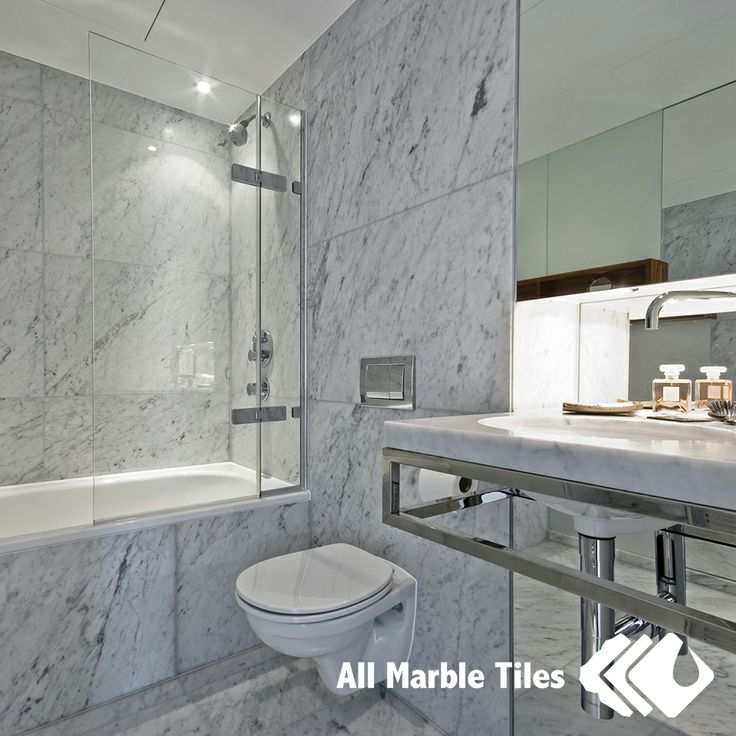 Bathroom design with bianco carrara marble tile from www for Bathroom ideas marble tile