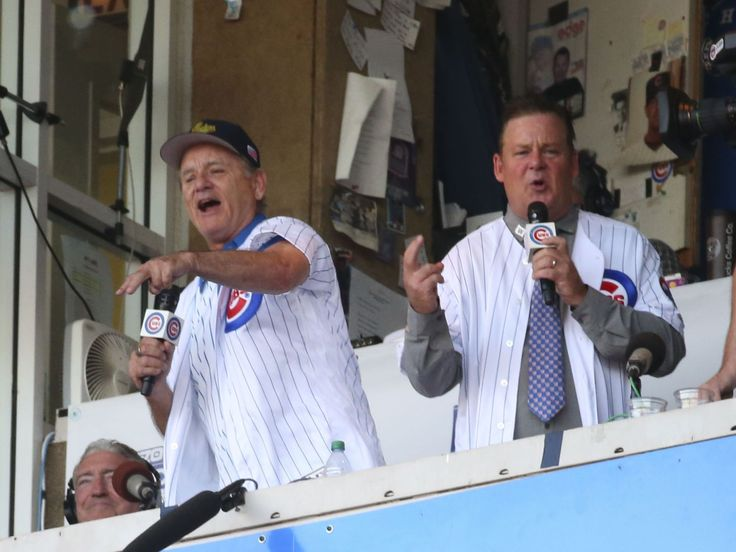 NLDS Game 3: Nationals at Cubs - Bill Murray (left) and Joel Murray (right) sing Take Me Out to the Ballgame during the seventh inning stretch.  Jerry Lai, USA TODAY Sports