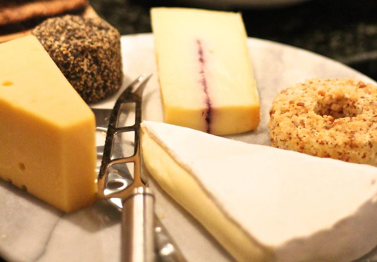 A great way to start the weekend: a glass of wine and a cheese plate.