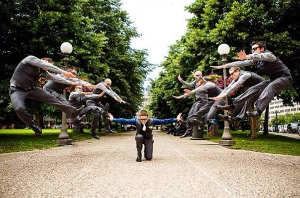 "Haha awesome groom and groomsmen picture - would be fun with the ""Ironman"" fist to the ground"