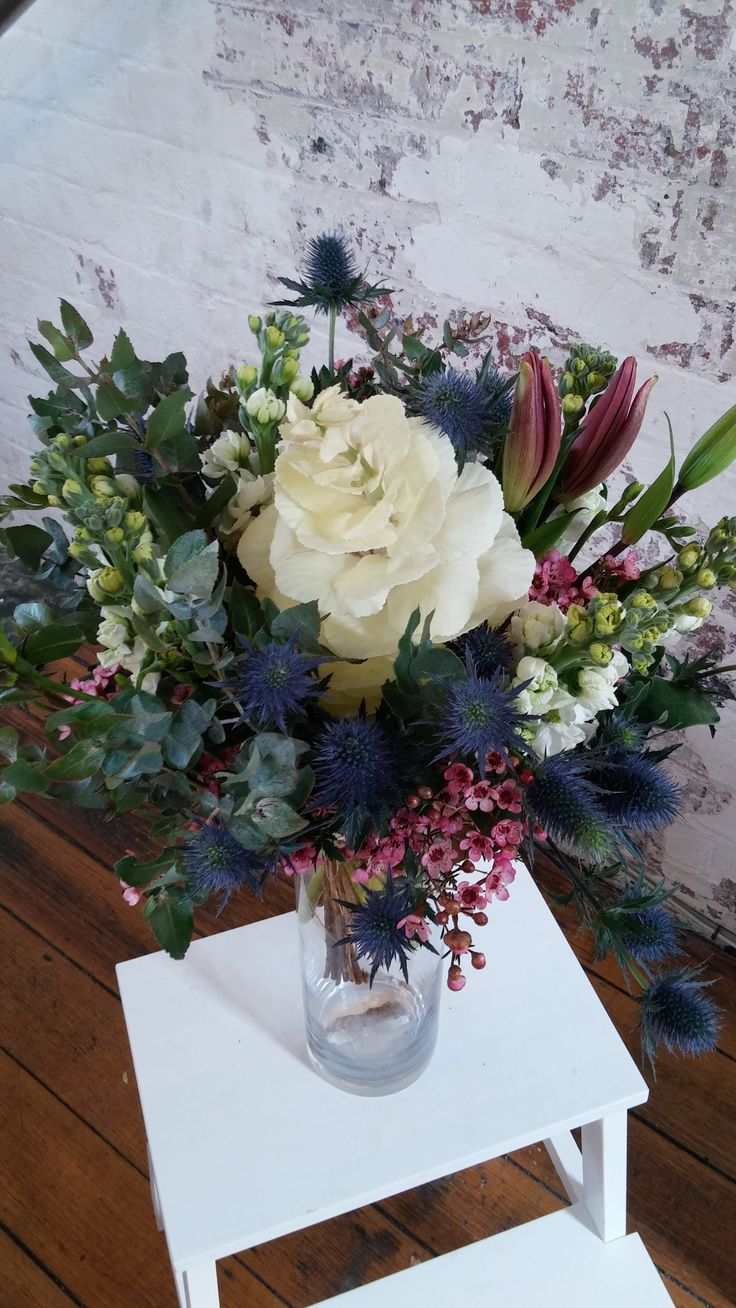 BOUQUET featuring the last of the season's kale, waxflower, stock, lilies, sea holly and eucalyptus.