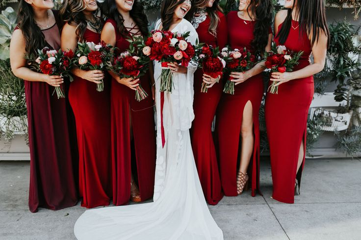 love the crimson reds flowers with a pop of peach/blush and greenery in all of these bouquets!