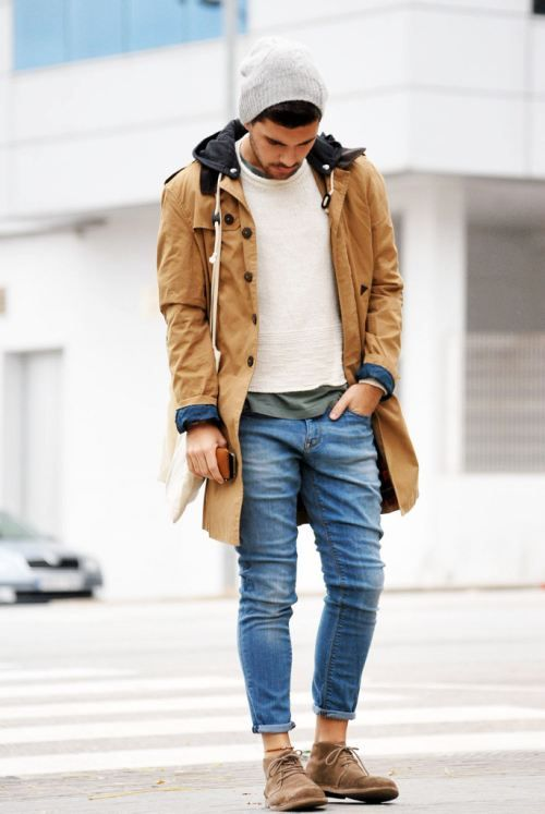 Shop this look for $96:  http://lookastic.com/men/looks/parka-and-beanie-and-crew-neck-sweater-and-crew-neck-t-shirt-and-jeans-and-desert-boots/847  — Tobacco Parka  — Beige Beanie  — White Crew-neck Sweater  — Grey Crew-neck T-shirt  — Blue Jeans  — Brown Suede Desert Boots