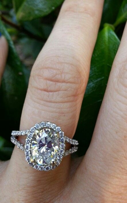 Oval diamond with split shank halo engagement ring
