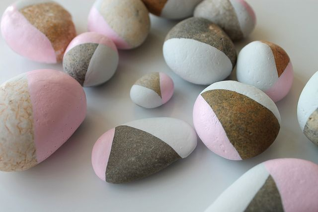 Pebbles are a'plenty at the beach so maybe buy paint tester pots and decorate away!