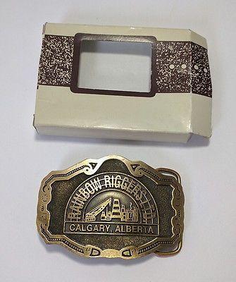 NOS Vintage Rainbow Riggers Solid Brass Belt Buckle Oil Rig Calgary, Alberta NEW
