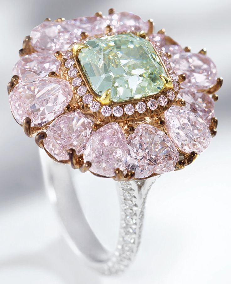 Rare green and pink diamond ring - centring on a cut-cornered square modified brilliant-cut fancy green diamond weighing 2.00 carats, surrounded by variously-shaped pink diamonds, the shoulders set with circular-cut diamonds, the pink diamonds and diamonds together weighing approximately 6.25 carats, mounted in 18 karat white and pink gold.