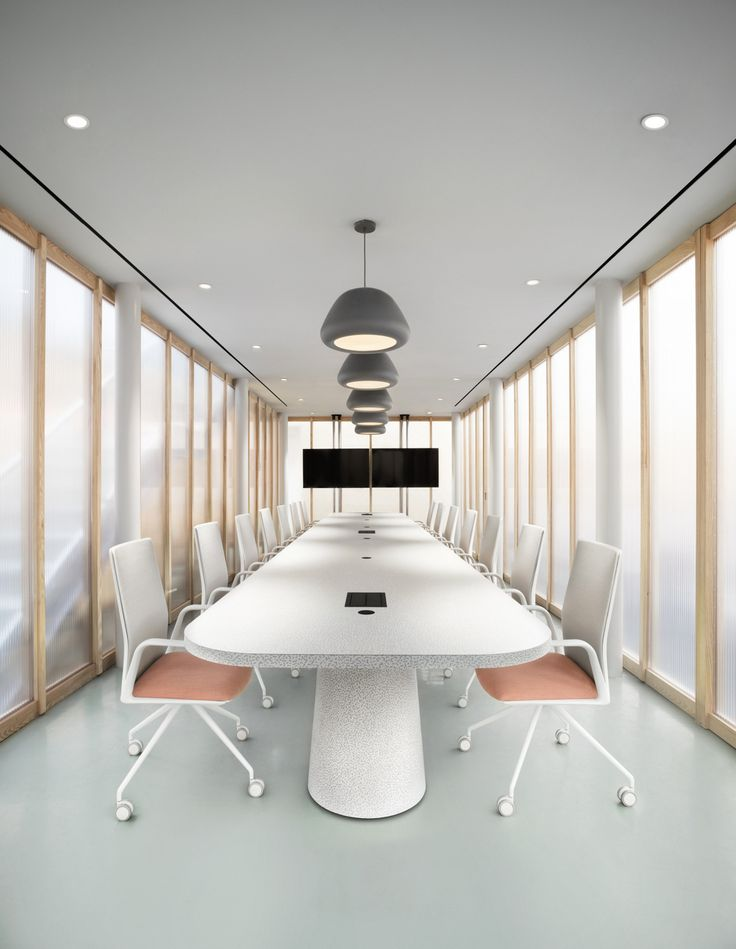 white and pale pink boardroom