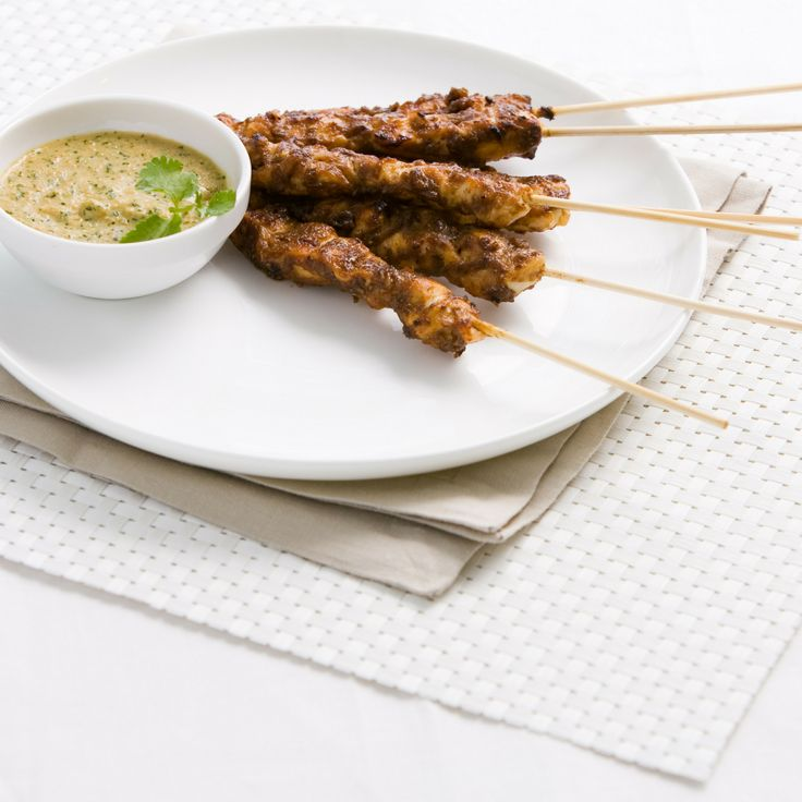 Indonesian chicken satay with peanut sauce. We can honestly say this is the best chicken satay recipe we've ever tried. The recipe looks complicated, but roasting your own spices and using real peanuts in the peanut sauce truly elevate the popular dish.