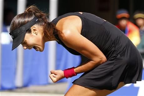 Ana Ivanovic of Serbia reacts after getting a point against Caroline Wozniacki of Denmark during their final match of the Pan Pacific Open Tennis tournament in Tokyo Sunday, Sept. 21, 2014. Ivanovic won the match to win the tournament. (AP Photo/Shizuo Kambayashi) ▼21Sep2014AP|Ivanovic beats Wozniacki to win Pan Pacific Open http://bigstory.ap.org/article/90cc05e558474c969aa19a8b6e5a12ad/ivanovic-beats-wozniacki-win-pan-pacific-open