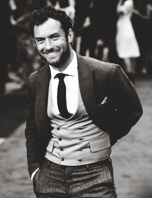 ohhhhhkay  I just figured out why Jude Law was the world's sexiest man, according to people or something, at one point. However, I would claim he was never better than in this photograph, because holy cow, son.  Fitted vests are not for everyone, and neither are tweedy trousers, but they couldn't have happened to a better man.  pure-evil:    (via TumbleOn)