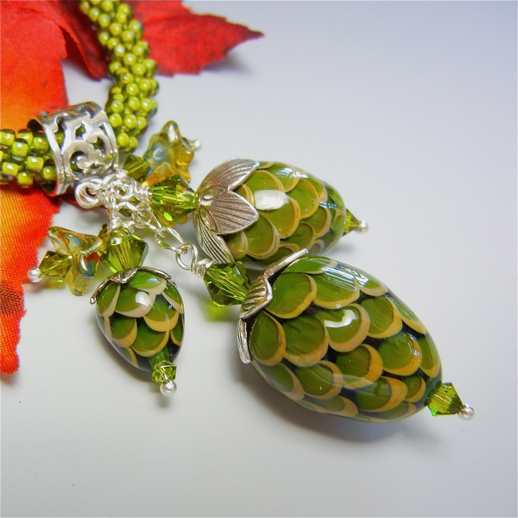 a cluster of lampwork glass pinecones on a sterling silver bail sra solason at on the edge gallery proud owner of this piece amazing work by sheila