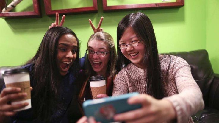 "Friends Amrita Mohanty, 16, from left, Marta Williams, 16, and Michelle Mao, 15, take a Snapchat ""selfie"" while having coffee at the Steepery Tea Bar in Woodbury, Minn., Dec. 12, 2013. (Renee Jones Schneider/Minneapolis Star Tribune/MCT)"