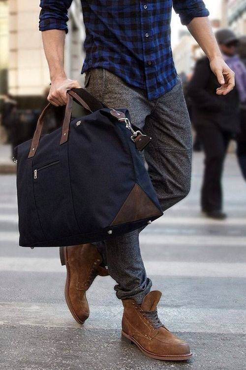 Shop this look for $239:  http://lookastic.com/men/looks/grey-dress-pants-and-brown-boots-and-navy-duffle-bag-and-navy-longsleeve-shirt/1708  — Grey Wool Dress Pants  — Brown Suede Boots  — Navy Canvas Duffle Bag  — Navy Plaid Longsleeve Shirt