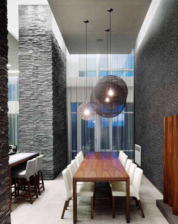 Daniels Limelight Condominiums | Mississauga, Ontario, Canada | Natural materials such as stone and reclaimed wood combine with modern details and vivid colors to connect the interior to the green space surrounding the building.