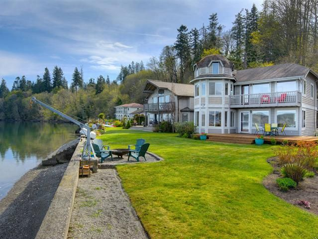 Special West facing no bank Hood Canal waterfront with mountain view. This idyllic little neighborhood is appropriately named Seclusion Cove. You feel like you can reach out and touch the water from this sweet 3 bedroom 2.25 bath 1994 sq ft home with spectacular scenery from almost every room. Lounge on the deck when the sun is out and take in the wildlife boats and sunsets. Make this your special get a way or live on the water full time. Dont miss the carport with bonus space above.