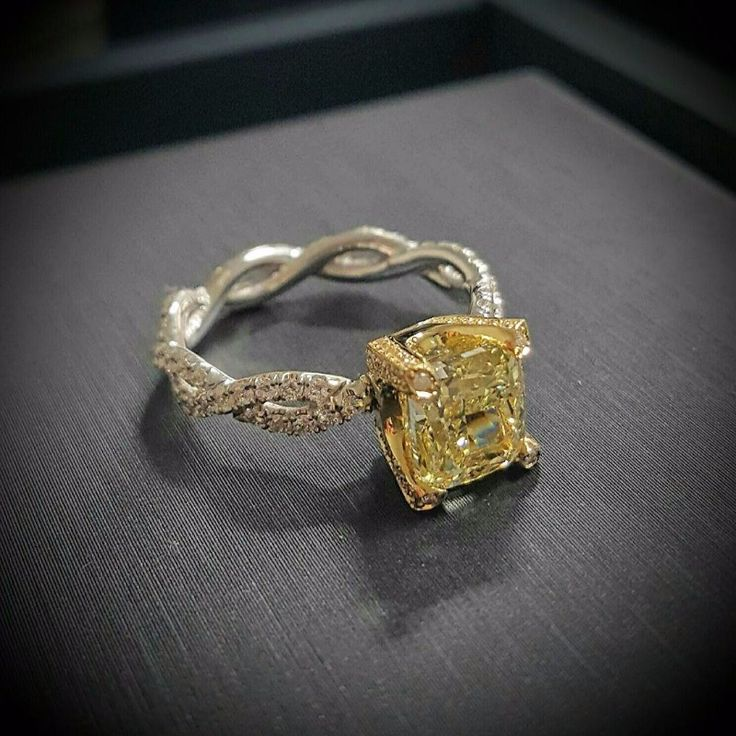 There's nothing common or boring about this yellow-diamond engagement ring with twisted band. Start custom designing your own version of this ring today!