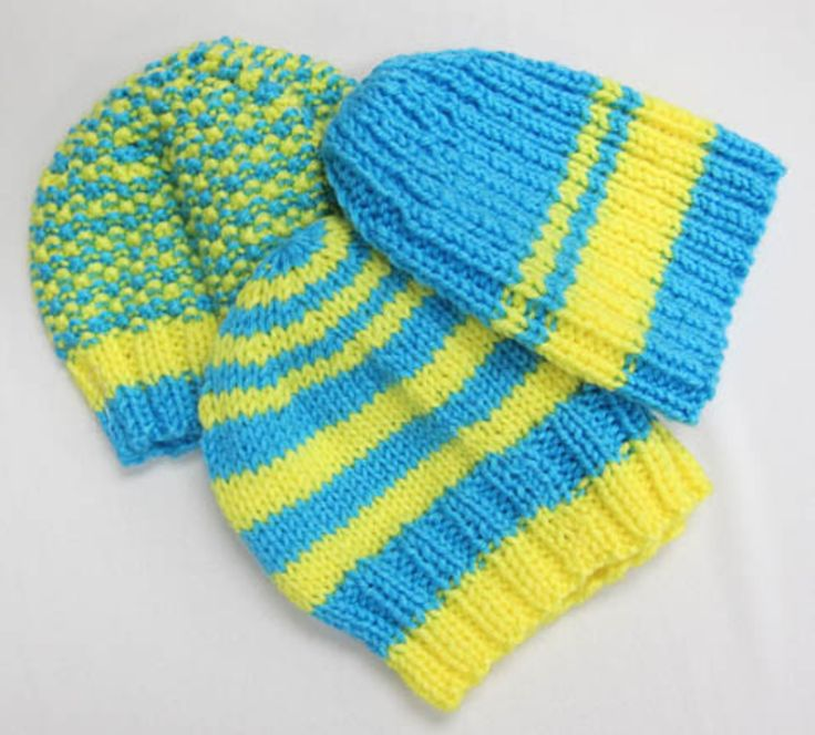 This soft, thick hand knit hat will keep you warm! In Ukrainian flag colours of blue and yellow in assorted stripe designs. Available at www.yevshan.com