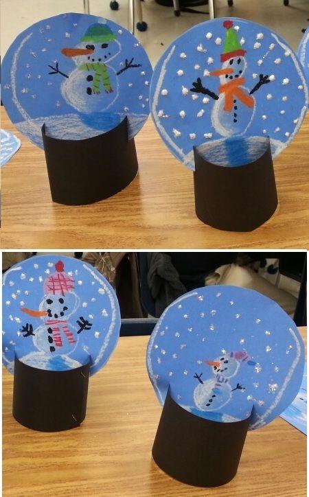 du papier de couleur + des feutres + des ciseaux = des boules de neige trompe l'œil en papier.