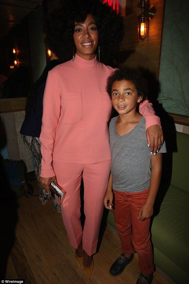 Protective mom: Solange Knowles fired back at an Instagram user who called her 11-year-old son Julez 'ugly' on Friday. Mother and son are pictured here in May 2014