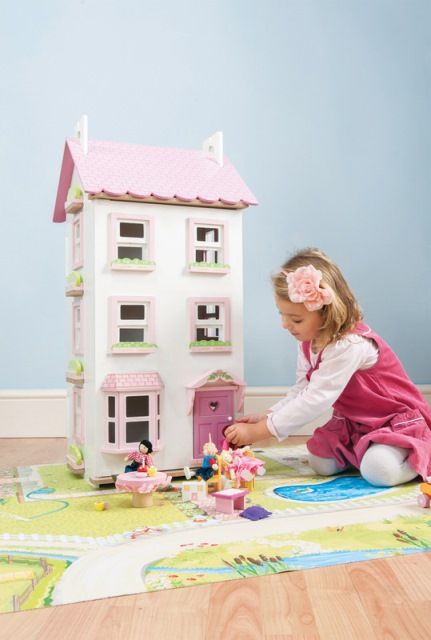 At a massive four storeys high, this pink and white painted doll's house from Le Toy Van has lots of great features like a bay window, special opening/closing sash windows and an opening front door to welcome guests #dolls #dollshouse #letoyvan