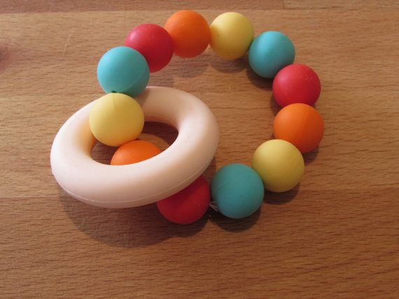 Silicone Teething Ring    A beautiful colourful teether that your baby will love!    The ring and beads are made from 100% food grade
