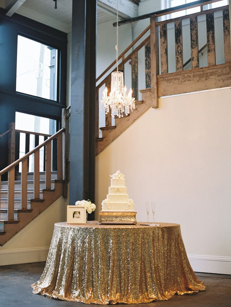 Now that is a cake table! Gorgeous gold sequin table!