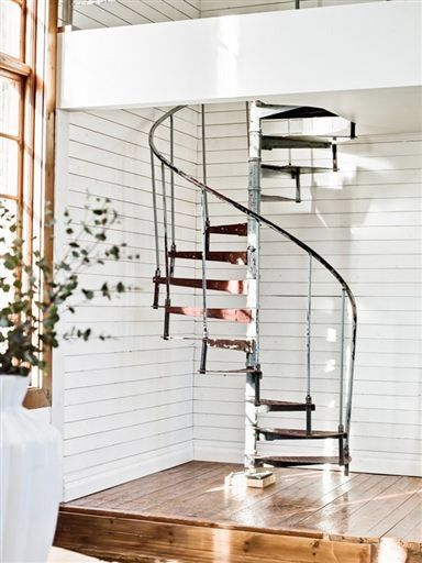 spiral staircase that toes the line between rustic and modern