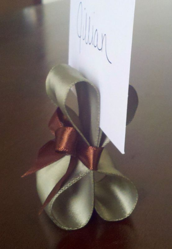 handmade place card holder. Looks like large and small ribbon....could make in any venue colors.