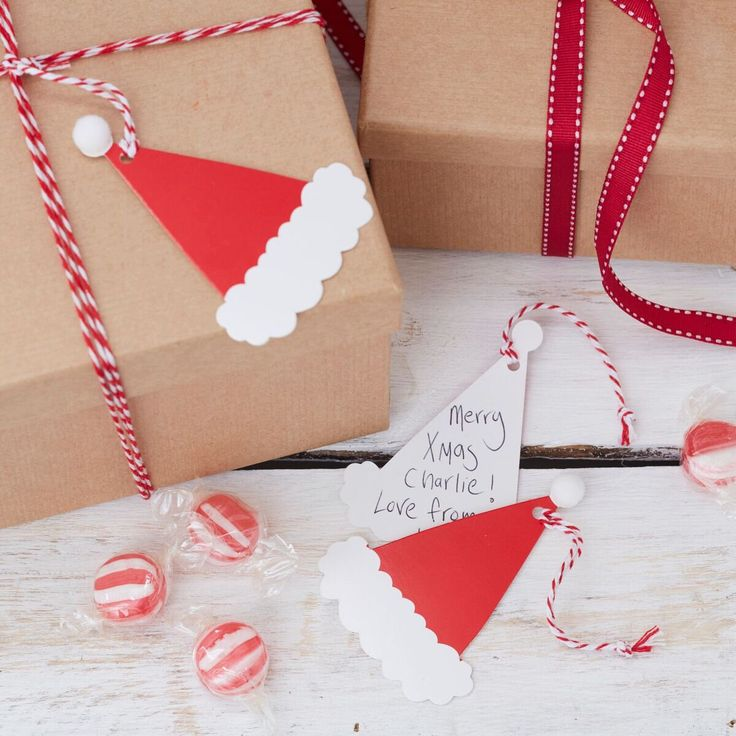 Santas Hat With Pom Poms Gift Tags, Christmas Gift Tags, Festive Gift Wrapping, Christmas Present Tags, Holiday Season Tags, 8 Pack by ThatPerfectPartyCo on Etsy https://www.etsy.com/listing/552905821/santas-hat-with-pom-poms-gift-tags
