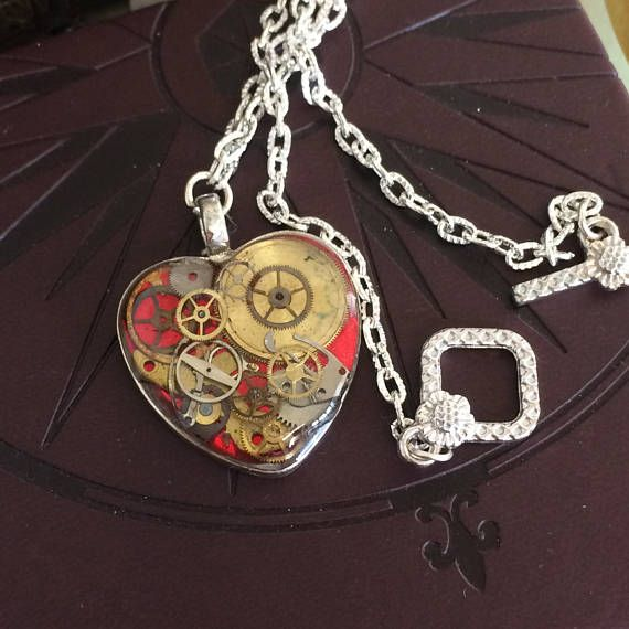 Steampunk Pendant. A red heart with lost of genuine watch parts and cogs embedded in clear resin  Comes on a SP chain with decorative toggle clasp.  Choose your own chain length  This pendant comes in its own little box all ready to give as a gift.    To return to my shop http://www.inspiredbysteampunk.etsy.com  Or why visit us on Facebook at https://www.facebook.com/InspiredbySteampunk/ Meet the owner of InspiredbySteampunk