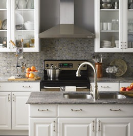 White kitchen + grey backsplash and granite with pops of color