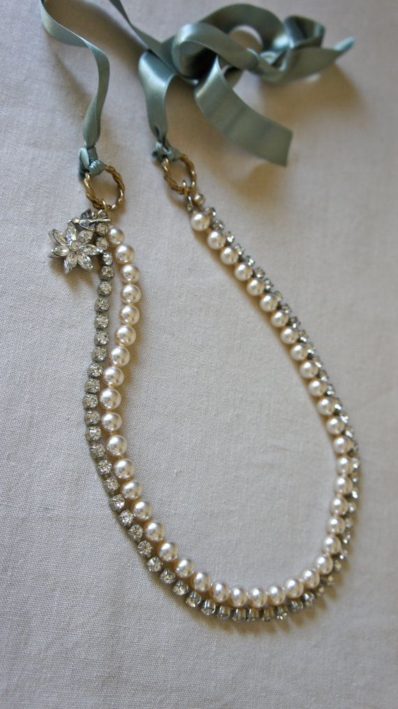 Ribbon necklace with vntage rhinestones, faux pearls and vintage jewelry charms.