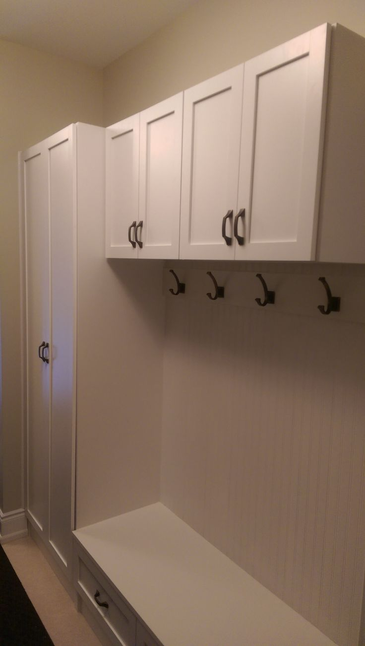Coat hooks, custom bench and storage in a mud room