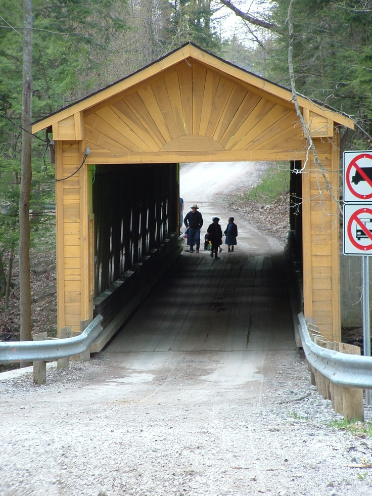 Covered Bridge being crossed by Amish children. I loved Lancaster, Pennsylvania