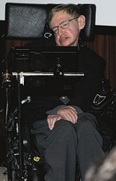 Hawking sitting in his wheelchair inside on 5 May 2006, during the press conference at the Bibliothèque nationale de France to inaugurate the Laboratory of Astronomy and Particles in Paris and the French release of his work God Created the Integers