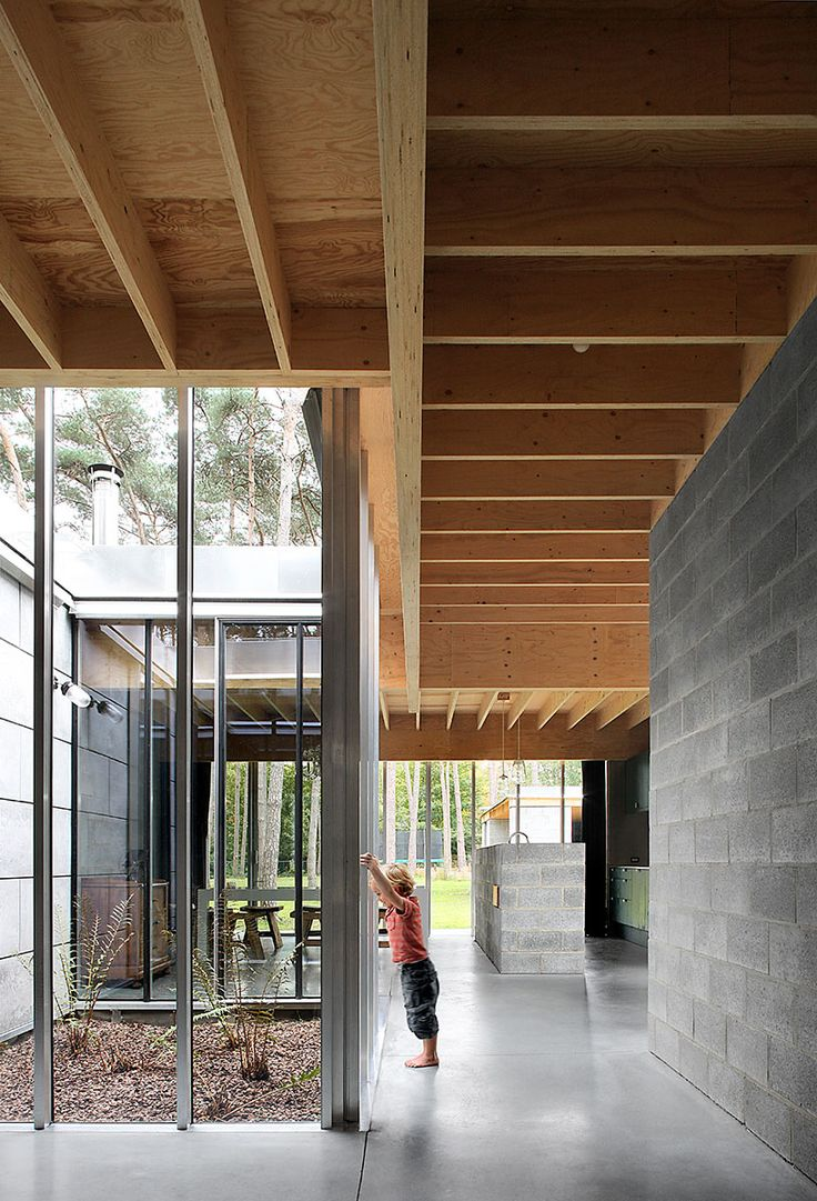 Waasmunster House | a concrete slab, masonry in concrete blocks, a wooden roof, simple greenhouse glazing, drains designed as spouts, prefab concrete wall cladding as countable oversized stones…