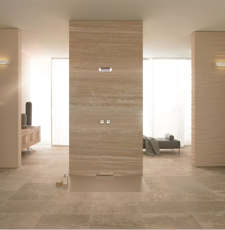 Epic The new enamelled shower surface with its integrated wall outlet blends perfectly with the bathroom floor