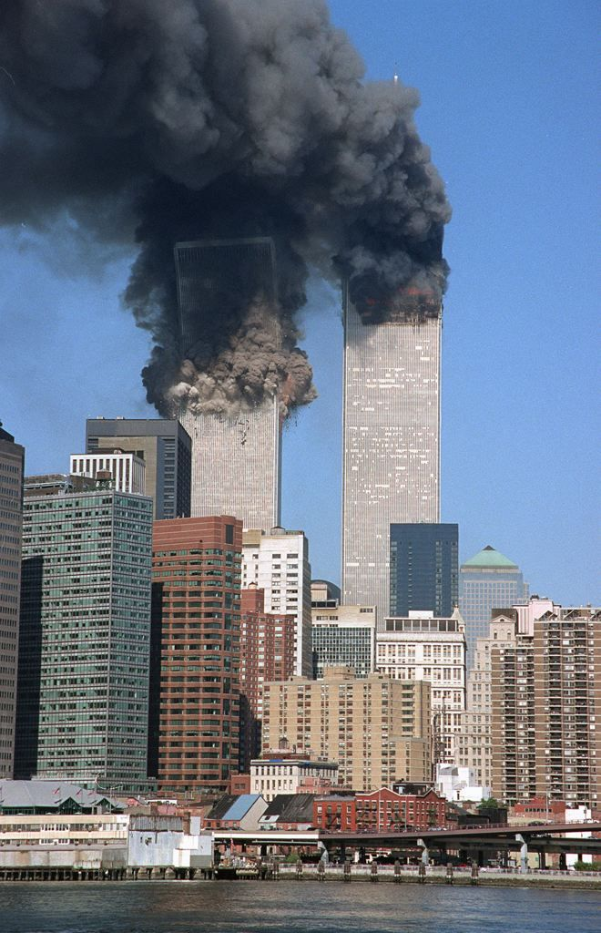 The south tower begins to collapse as smoke billows from both towers of the World Trade Center, in New York, on Sept. 11, 2001. In one of the most horrifying attacks ever against the United States, terrorists crashed two airliners into the World Trade Center in a deadly series of blows that brought down the twin 110-story towers. (AP Photo/Jim Collins