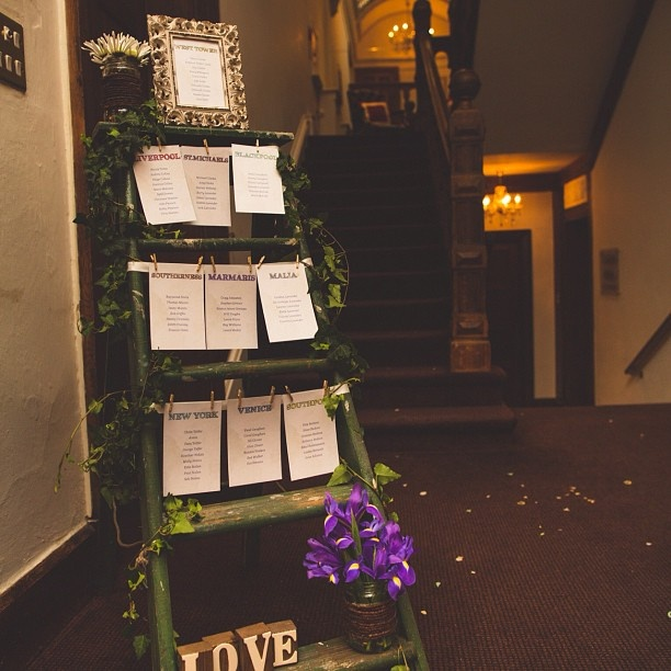 A great wedding table plan made using an old step ladder.