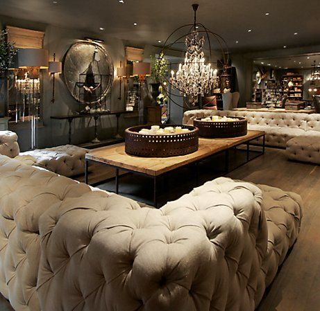 LOVE these tufted U sofas... perfect thing to keep a formal living room formal while making it look cozy and inviting at the same time.